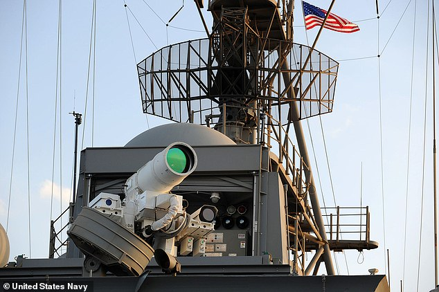 9096966-7655661-Real_laser_in_action_The_USS_Ponce_was_equipped_with_an_XN_1_LaW-a-2_1573042283551